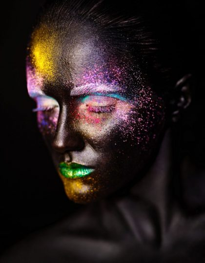 art photo of beautiful model woman with creative plastic unusual black mask bright colorful makeup with black face elementor